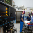 Operation room in clinic with medical staff during surgery - Stock Photo