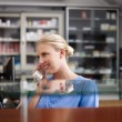 Stock Photo: Woman working as nurse in clinic and speaking on telephone