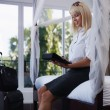 Businesswoman sending email on touch pad computer — Stock Photo