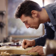 Italian artisan working in lutemaker workshop - Stock Photo
