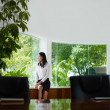 Businesswoman contemplating out of window in meeting room — Stock Photo #9754750
