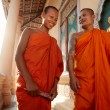 Two monks meet and salute in a buddhist monastery, Asia - 