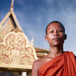 Portrait of buddhist monk near temple, Cambodia, Asia - Stock Photo