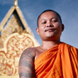 Portrati of buddhist monk near temple, Cambodia, Asia - Stock Photo
