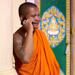Asian buddhist monk talking with mobile phone in temple - Stockfoto