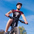 Stock Photo: Young man training on mountain bike