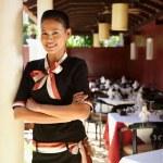 Portrait of asian waitress working in restaurant — Stock Photo