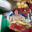 Stock Photo: Portrait of Asiwomselling street food in Cambodia