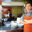 Man working as cook in Asian restaurant kitchen — Stock Photo