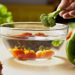 Tomatoes, broccoli and vegetables on kitchen table - Stock Photo