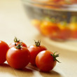 Stock Photo: Red tomatoes on kitchen table