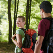 Royalty-Free Stock Photo: Couple with backpack doing trekking in wood