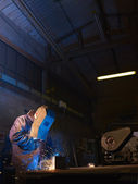Man at work as welder in heavy industry — Stock Photo