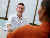 Gynecologist working and talking to woman in clinic — Stock Photo