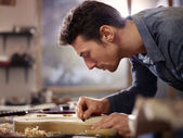Italian artisan working in lutemaker workshop — Stock Photo