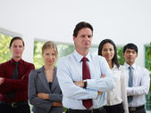 Portrait businesspeople smiling and looking at camera — Stock Photo