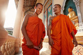 Two monks meet and salute in a buddhist monastery, Asia — Stock Photo