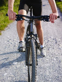 Young man training on mountain bike — Stok fotoğraf