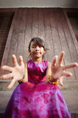 Cute and happy little Asian girl smiling at camera — Stock Photo