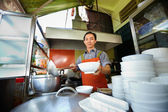 Man working as cook in Asian restaurant kitchen — Photo