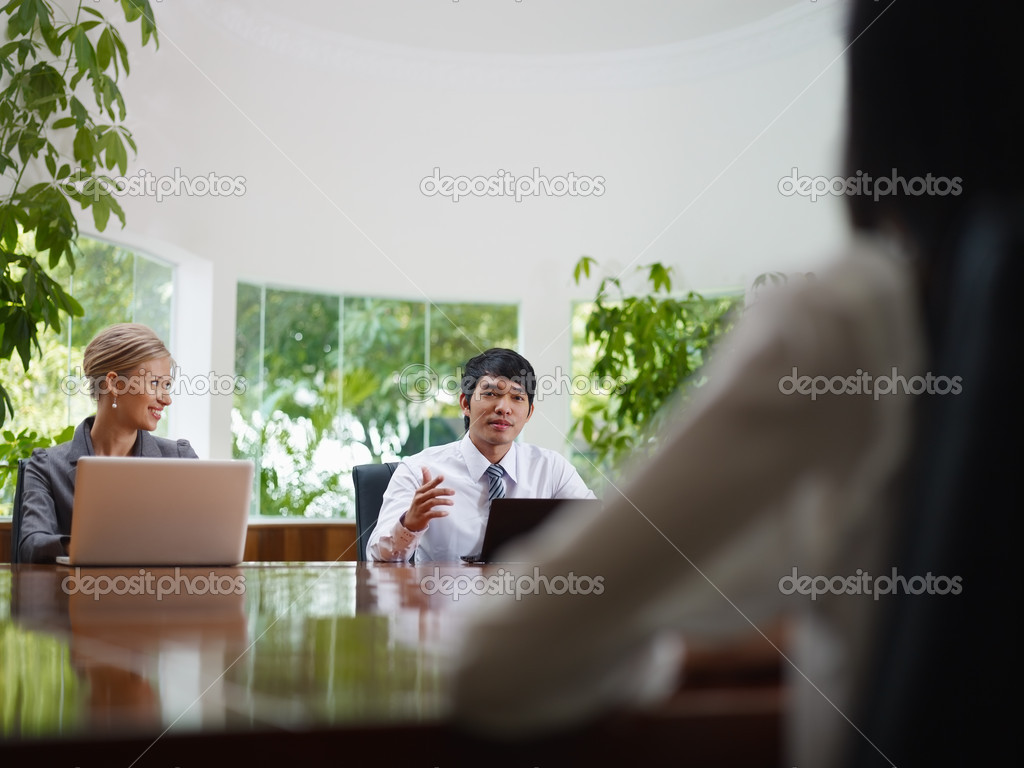 Young business with laptop computers at meeting in conference room. Front view, copy space — Foto Stock #9754317