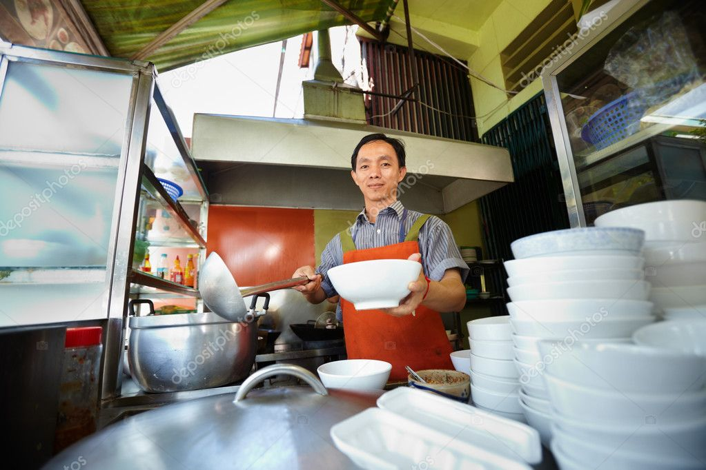 Chef preparing traditional Asian street food and working in the restaurant kitchen. Horizontal shape, front view  Stock Photo #9757846