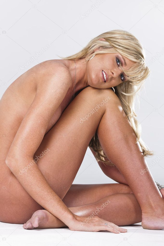 Nude blonde model against a white background — Stock Photo #8772762