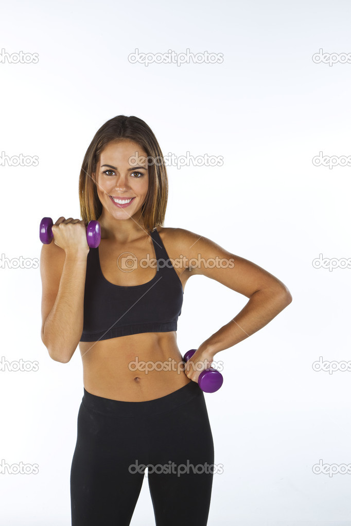 A brunette fitness model preparing to work out — Stock Photo #9385692