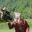 Young woman feeding a cow — Stock Photo