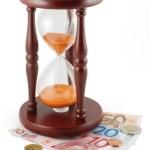 Hourglass and money — Stock Photo