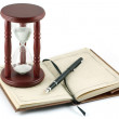 Hourglass, fountain pen and a notebook — Stock Photo