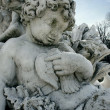 Foto Stock: Detail of cherub sculpture of Bacchus