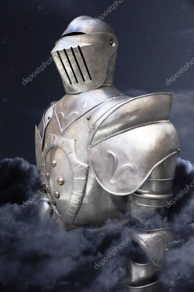 Soldier in armor enveloped in clouds with the night sky behind — Stock Photo #8617287