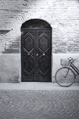 Black and white antique facade and bicycle — Stock Photo