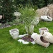Stock Photo: Old vases in garden