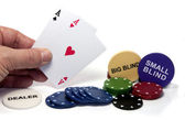 Hand with two aces during poker game — Stock Photo