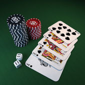 Casino chips, dice, cards on the green cloth — Stock Photo