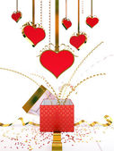 Gift box Valentine's Day, red hearts with golden ribbons — Stock Photo