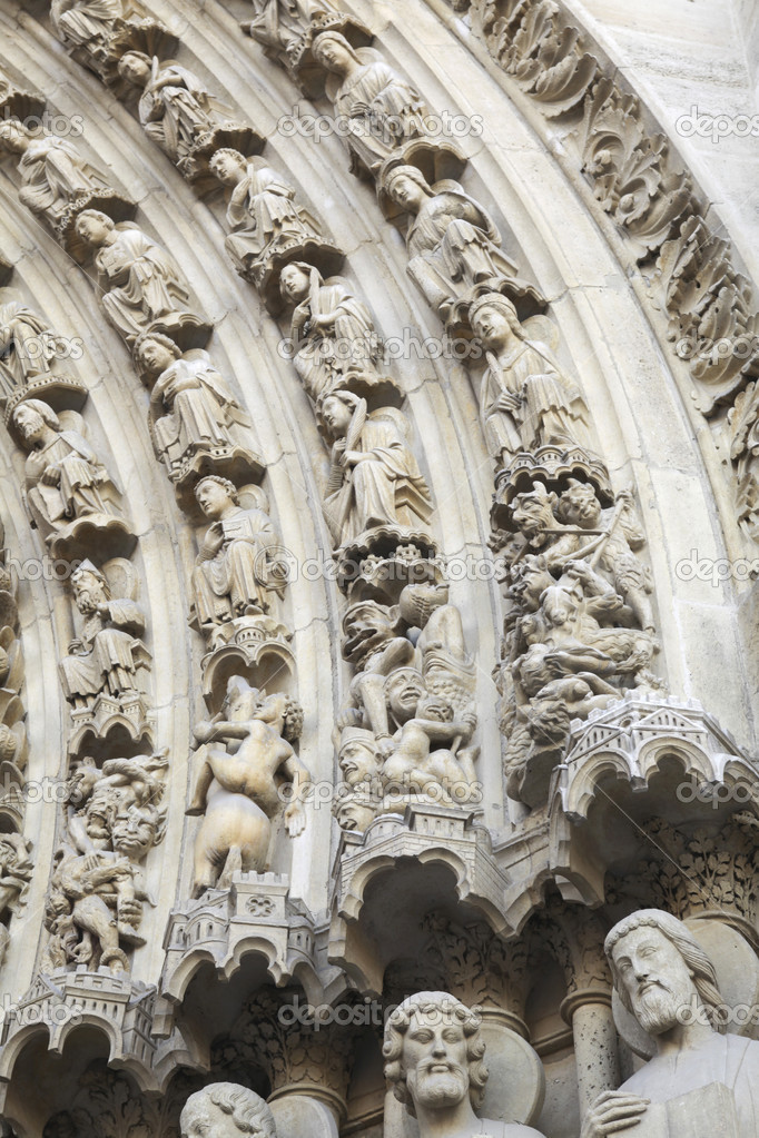 Details of the entrance of the notre dame in Paris with small statues  Stock Photo #8517128