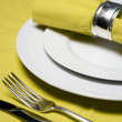 Table setting in yellow - Stock Photo