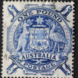 Vintage oOne pound blue postage stamp printed in Australia - Stock Photo