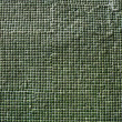Close up of green ceramic tiles on historical wall — Stock Photo