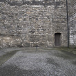 Cross on execution spot at old prison - Stock Photo