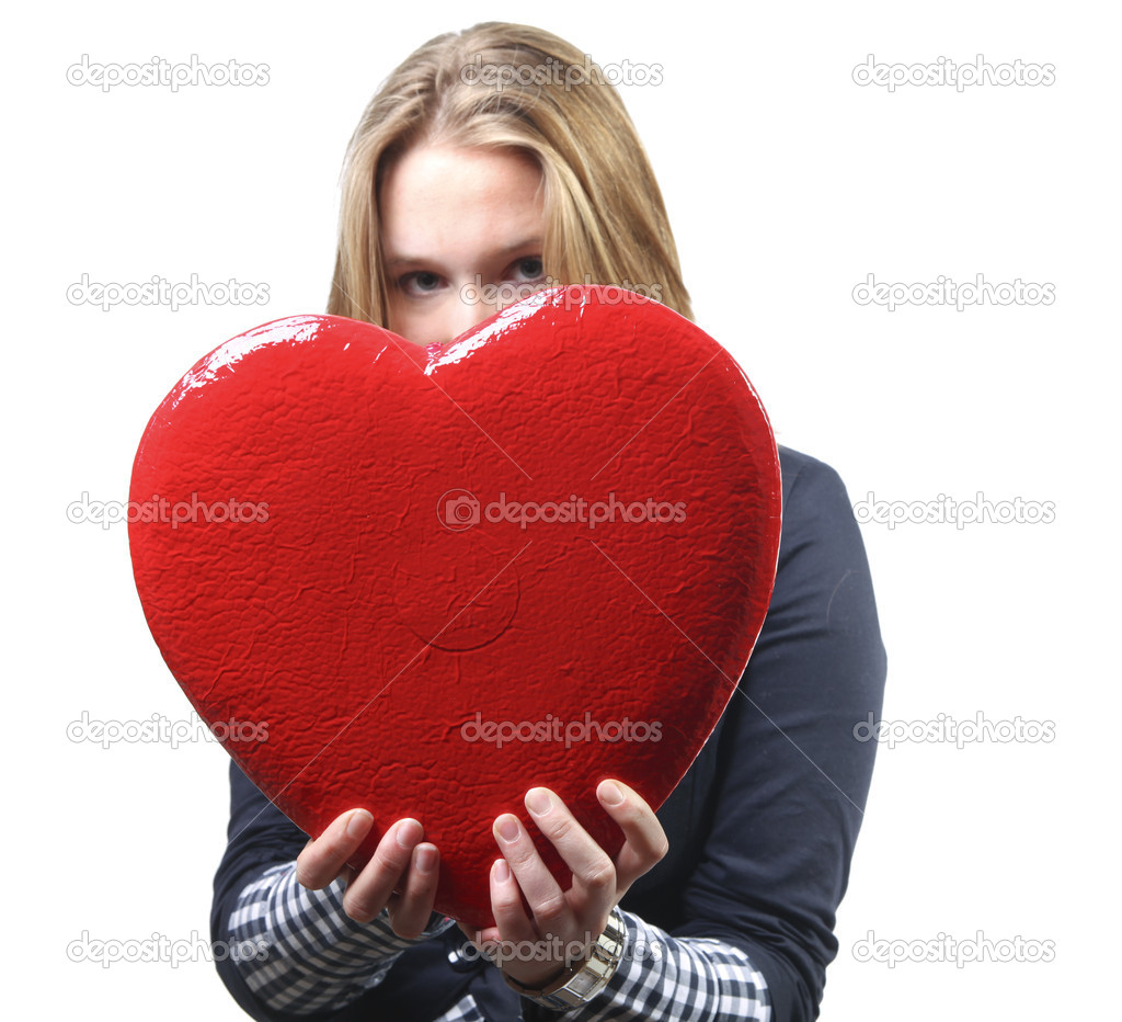 Pretty young woman giving a valentine's heart — Stock Photo #8816210