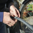 Fixing flat bicycle tire — Stockfoto