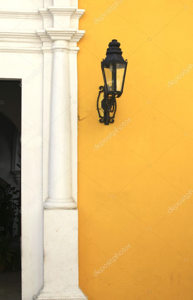 Lantern on a yellow wall — Stock Photo #8995315