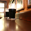 Two dark Irish stout beers — Stock Photo