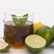 Tea and limes - Stock Photo
