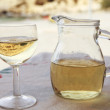 Matala reflection in white wine — Stock Photo