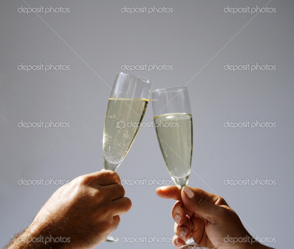 Two hands with champagne flutes toasting in sun — Stock Photo #9026252